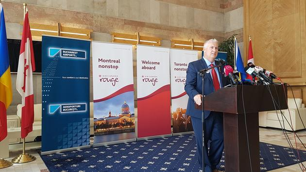 Duncan Bureau speaks at the press conference on arrival in Bucharest.