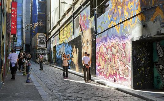 Tourists snapping photos of street art on Melbourne's Hosier Lane