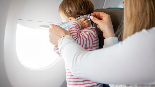 A toddler on a plane