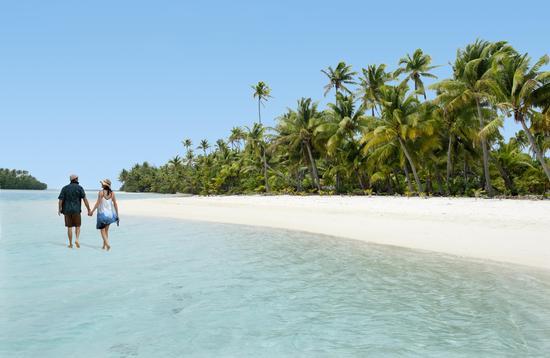 Couple Walk on Aitutaki Lagoon Cook Islands