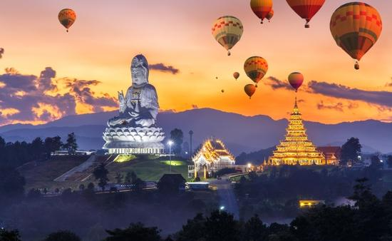 Colorful hot air balloons flying over Wat Huay Pla Kang