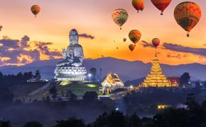 Colorful hot air balloons flying over Wat Huay Pla Kang