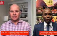 John Kirk of TravelPulse Canada and Saint Lucia Tourism Minister Dominic Fedee