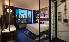 guest room at hotel emc2 with city view steampunk furnishings
