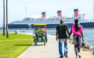 People tour the waterfront in Long Beach, California
