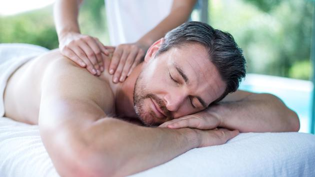 Man receives relaxing back massage