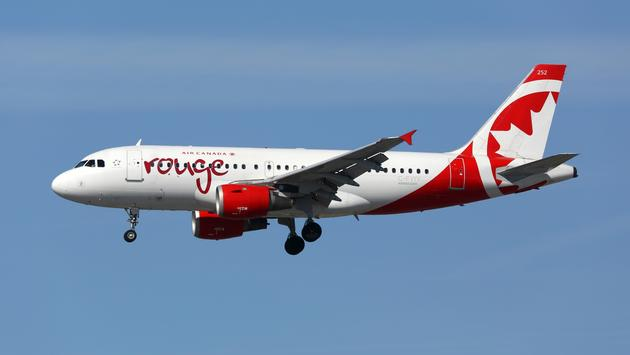 An Air Canada Rouge Airbus A319 landing at LAX