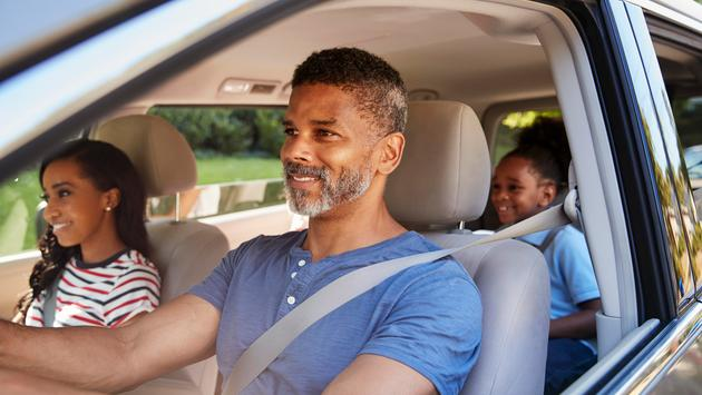 Family In Car Going On Road Trip