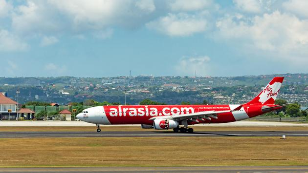 AirAsia airplane taxiing at tarmac in Bali Ngurah Rai International Airport