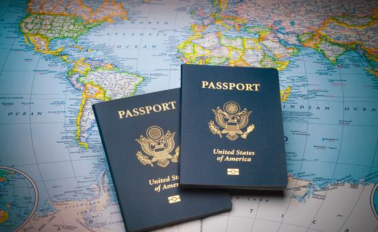 U.S. passports on a global map.