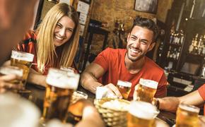 Drinking beer at brewery bar restaurant (Photo via ViewApart / iStock / Getty Images Plus)