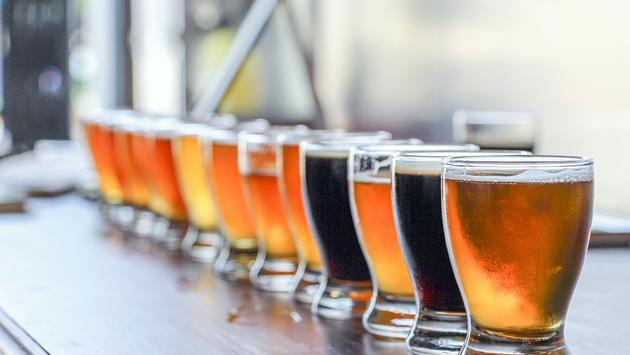 Craft Beer Tasting Display featuring sours, ales, stouts, IPA's and more (Photo via EddieHernandezPhotography / iStock / Getty Images Plus)