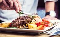 Freshly prepared steak and vegetables.