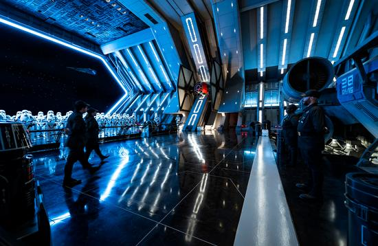 A TIE fighter sits docked on the First Order star destroyer on Walt Disney World's Rise of the Resistance at Star Wars: Galaxy's Edge