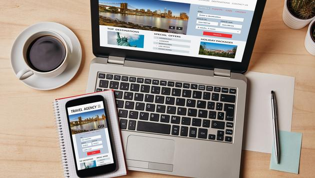 Travel agency concept on laptop and smartphone screen