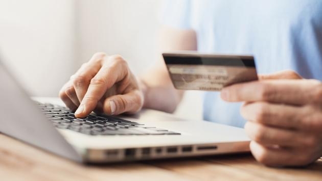 Man shopping online with a credit card