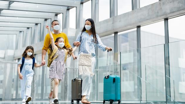 Family with two children going on holiday.