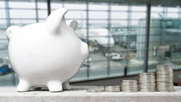 Airport piggy bank and coins