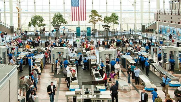 People traveling through security to the gates of Denver International Airport