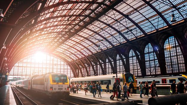 Trains traveling through Amsterdam Central Station