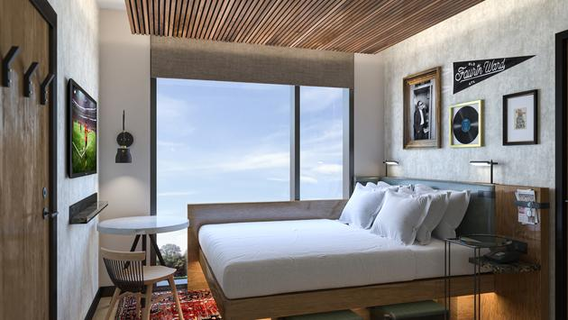 Dorm style guest room at Motto by Hilton