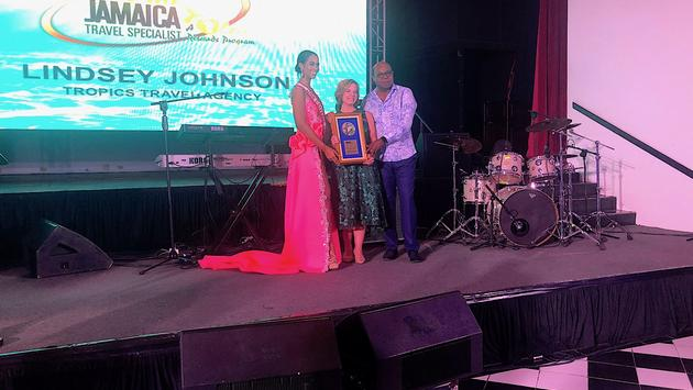 One Love Winner Lindsey Johnson with Jamaica Tourism Minister Edmund Bartlett and Miss Universe Jamaica