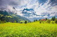 Alpine scenery with traditional mountain chalets in Grindelwald, Switzerland