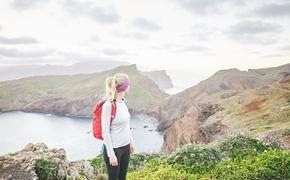 A woman hiking Portugal's Ponta de Sao Lourenco