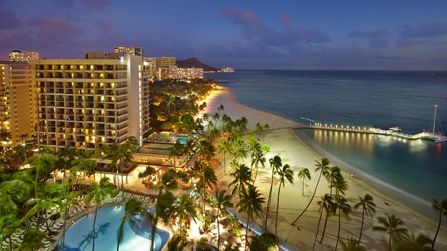 PHOTO: Hilton Hawaiian Village® Waikiki Beach Resort Alii Tower Exterior Dusk (photo via © 2019 Hilton)
