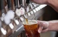 A pint of craft beer being poured