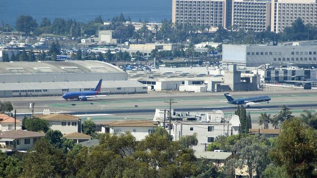 Planes landing and taking off at San Diego International Airport