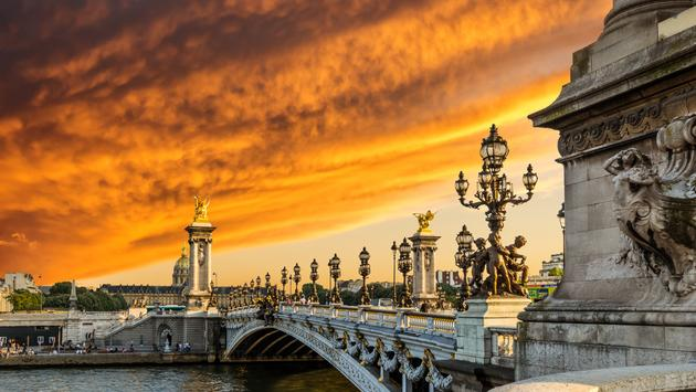 Paris bridge at sunset.