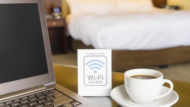 Hotel room with WiFi sign