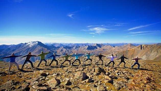 Mid-hike Yoga atop Colorado's Mt. Oxford