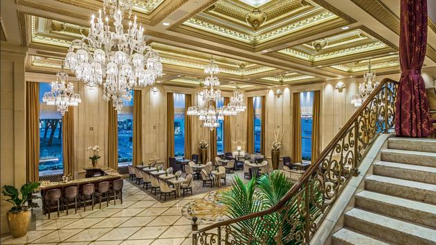 Hotel lobby with chandeliers and plush seating