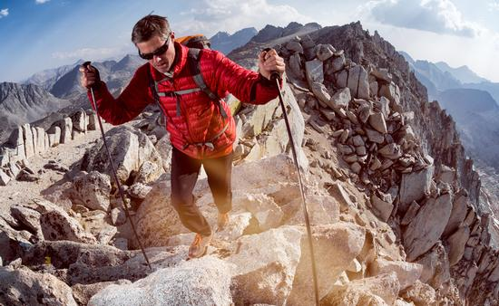 A man hiking the Sierra Nevada mountain range in California.