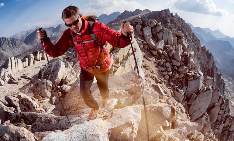 A man hiking the Sierra Nevada mountain range in California.