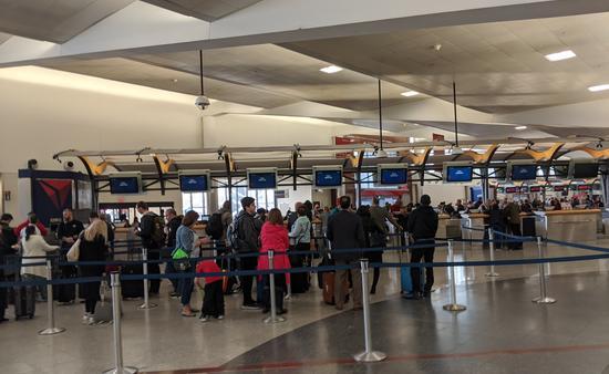 Travelers at airport line