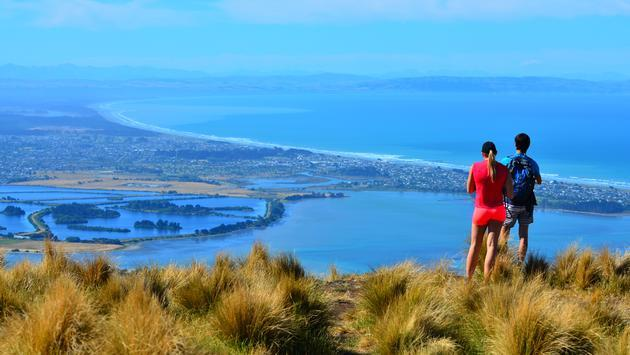 Couple look at the landscape view of Christchurch, New Zealand