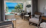 $1,000 Instant Credit: Beachfront Penthouse Club Level Suite with Balcony Tranquility Soaking Tub