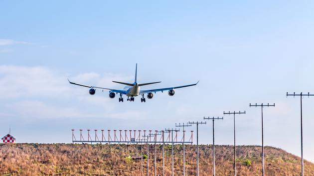 Plane landing at O.R. Tambo International Airport in Johannesburg.