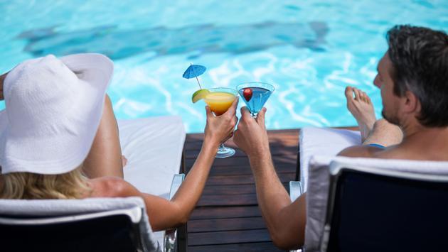 couple toasting martini glass