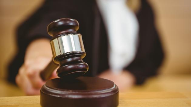 Judge with gavel.