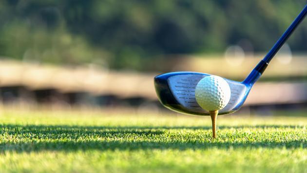 Golfer teeing off, golf