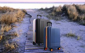 Roam Custom Color Luggage on a beach boardwalk