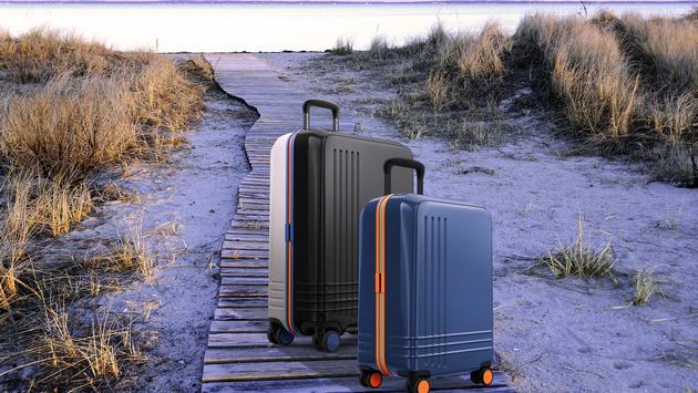 Roam Custom Color Luggage on a beach boardwalk
