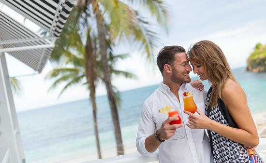 A couple at Couples Resorts, drinks