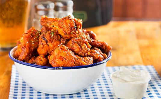 Chicken wings with blue cheese dip.