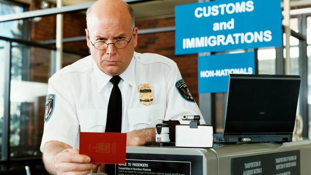 An airport Customs and Border Protection agent.