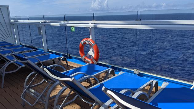 Cruise ship chairs overlooking ocean